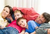 Family lying on the carpet — Stock Photo