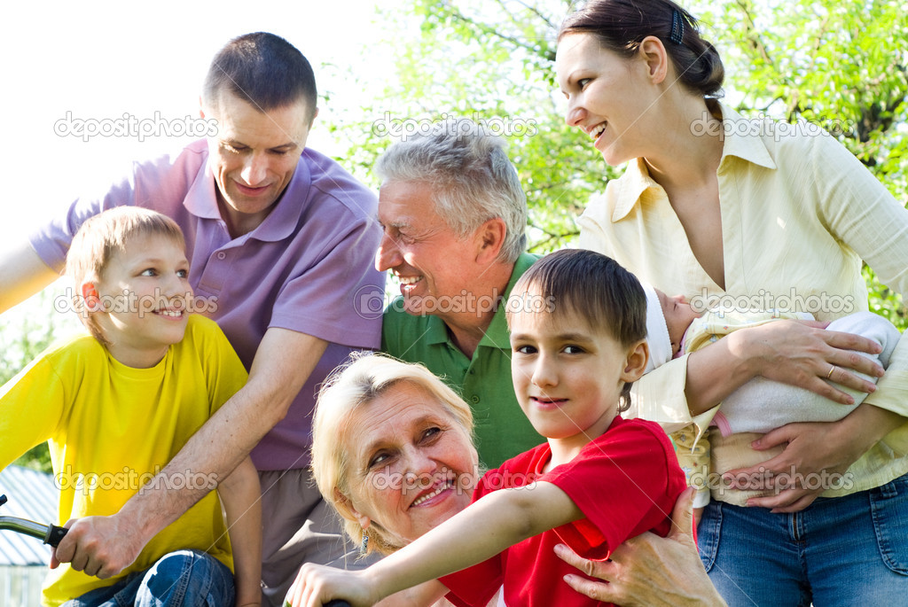 Large family plays in the summer park  Stock Photo #5509450
