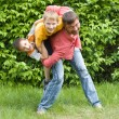 Stock Photo: Father playing with children