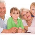 Elderly couple with their grandchildren — Stock Photo