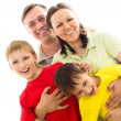 Happy family on a light — Stock Photo