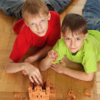 Stock Photo: Brothers are building on floor