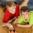 Stock Photo: Boys are building on the floor