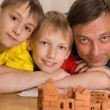 Stock Photo: Father with children playing