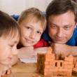 Father with children playing - Stock Photo