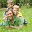 Stock Photo: Father with young children