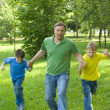 Father playing with children - Stock Photo