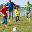 Royalty-Free Stock Photo: Happy family playing soccer