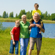 Couple with their grandchildren — Stock Photo #5511288