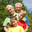 Couple with their grandchildren — Stock Photo #5511315
