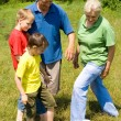 Elderly couple with their grandchildren — Stock Photo #5511321