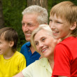 Elderly couple with their grandchildren — Stock Photo