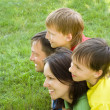 Stock Photo: Boys with family in park