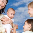 Mother with three children — Stock Photo #5512302