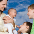 Young mother with three children — Stock Photo #5512312