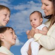 Young mother with three children — Stock Photo #5512319