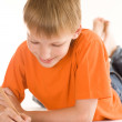 Boy lying and draw — Stock Photo #5512680