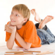 Boy lying and draw — Stock Photo #5512683