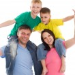 Happy family of four — Stock Photo #5513985
