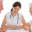 Woman doctor and an elderly couple — Stock Photo #5514341