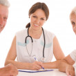 Woman doctor and an couple — Stock Photo #5514346