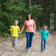 Family in forest — Stock Photo #5514525