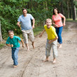 Family in forest — Stock Photo #5514537