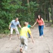Family walking in the forest — Stock Photo