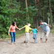 Royalty-Free Stock Photo: Family walking in the forest