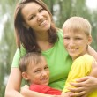 Boys with mom in the park - Stock Photo