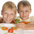 Beautiful boys holding a plate - Stock Photo