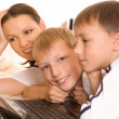 Mom with sons is on the carpet — Stock Photo