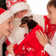 Santa gives presents to children — Stock Photo