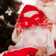 Santa gives presents to child — Stock Photo