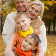Family of four in a park — Stock Photo #5516126