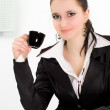 Woman drink in a black business suit — Stock Photo