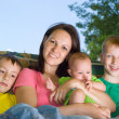 Happy children with mother — Stock Photo