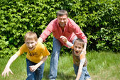 Father playing with two children — Stock Photo