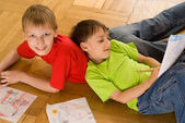 Two brothers lying and draw — Stock Photo