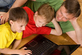 Father with sons with laptop — Stock Photo