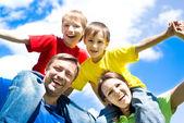 Happy boys with parents — Stock Photo