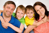 Happy parents and children together — Stock Photo