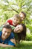 Happy boys with family — Stock Photo