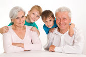 Happy grandparents with their grandsons — Stock Photo