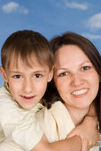 Happy woman with son — Stock Photo