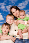 Young mother with her children — Stock Photo