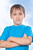 Boy stand against the sky — Stock Photo