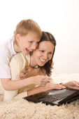Happy mom and son playing with laptop — Stock Photo