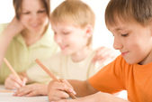 Mother draws with sons — Stock Photo