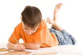 Boy lying and draw — Foto Stock